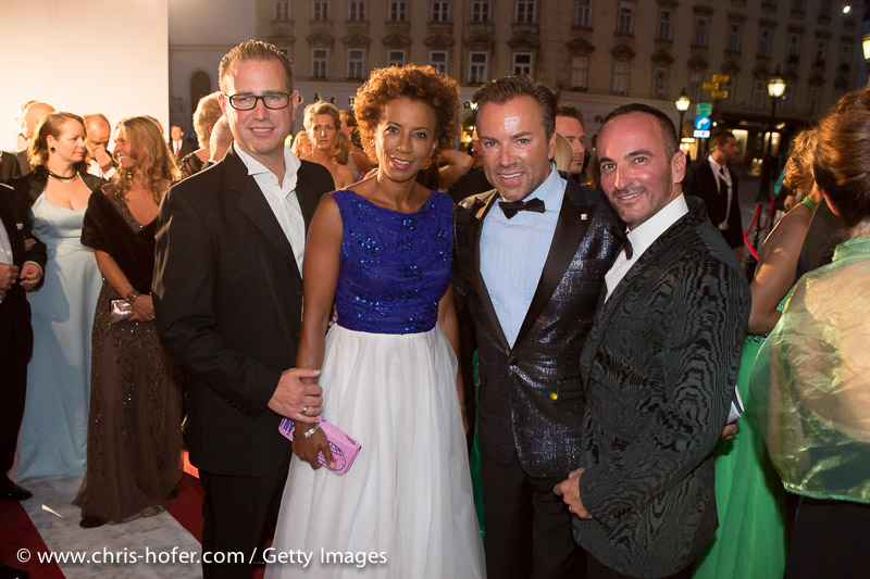 VIENNA, AUSTRIA - JUNE 26: Arabella Kiesbauer with her husband Florens Eblinger and Uwe Kroeger with Christopher Wolf attend the Fete Imperiale 2015 on June 26, 2015 in Vienna, Austria.  (Photo by Chris Hofer/Getty Images)